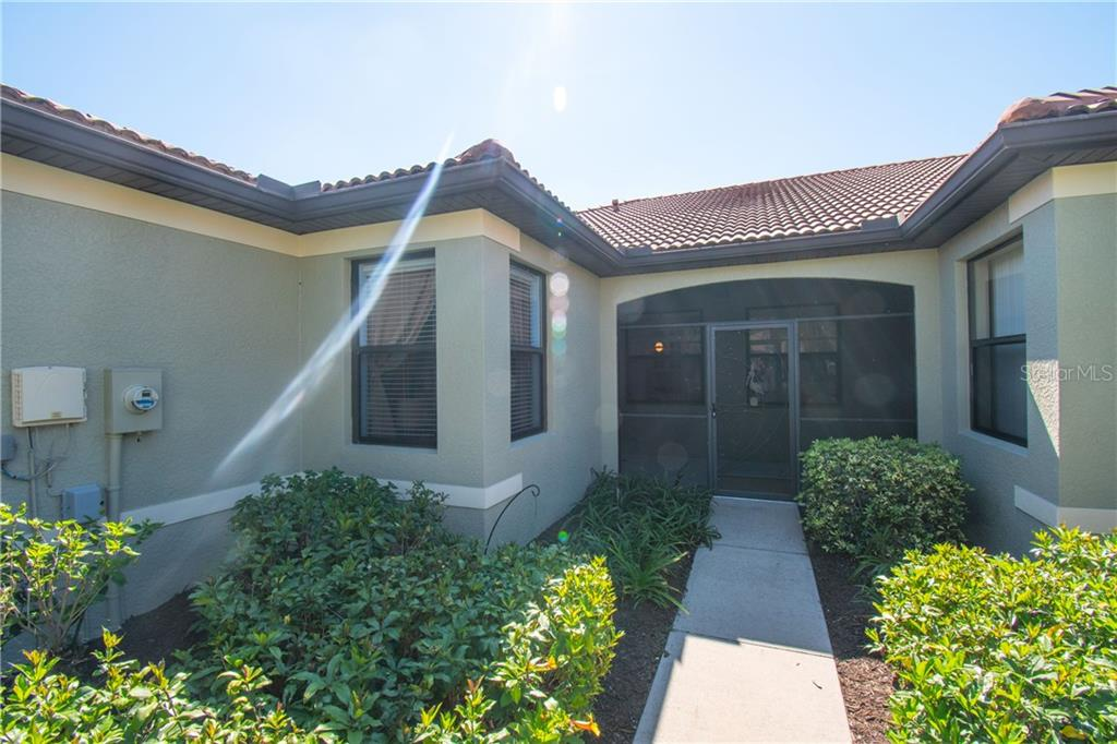 The entryway to screened in front porch - Villa for sale at 1808 Batello Dr, Venice, FL 34292 - MLS Number is A4426491
