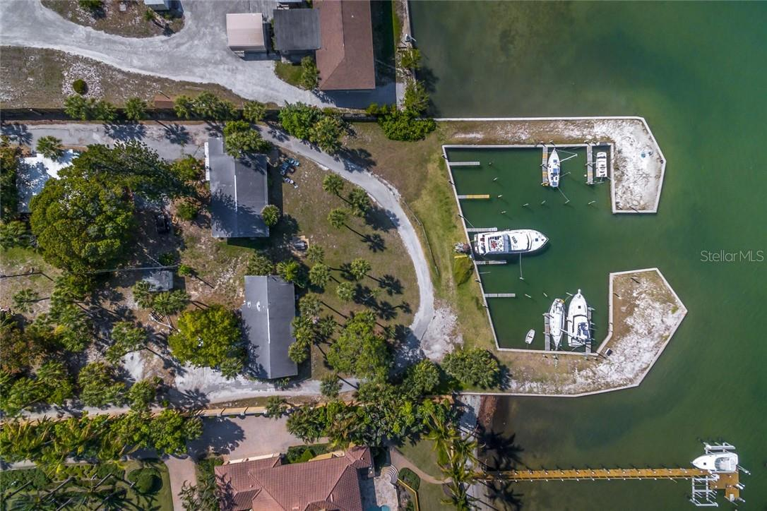 protected dockage for up to 45' Boats.  Duplexes shown are above flood zone. - Vacant Land for sale at 1649 Bayshore Rd, Nokomis, FL 34275 - MLS Number is A4426786