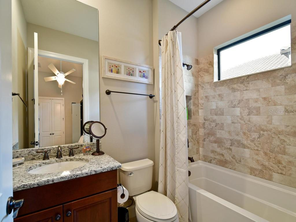 Granite counters, Tub and shower combination with lovely tile work! - Single Family Home for sale at 13707 Palazzo Ter, Bradenton, FL 34211 - MLS Number is A4427731