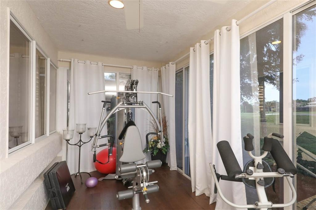 Long Florida room overlooks golf course with sweeping views - Single Family Home for sale at 7728 Club Ln, Sarasota, FL 34238 - MLS Number is A4428061
