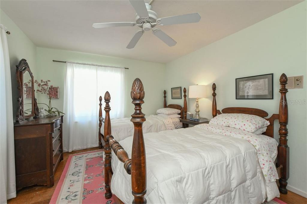Bedroom 2 easily accommodates either twin beds or a king sized bed and has a large walk-in closet. - Single Family Home for sale at 7727 Westmoreland Dr, Sarasota, FL 34243 - MLS Number is A4430900