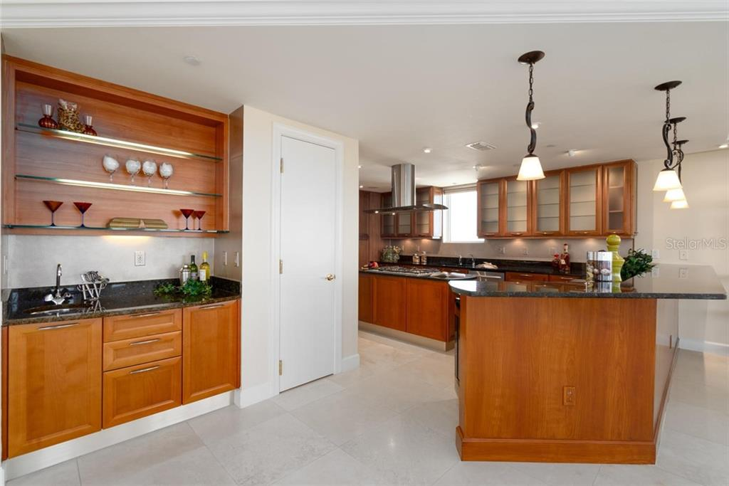 A great open kitchen and separate wet bar! - Condo for sale at 128 Golden Gate Pt #902a, Sarasota, FL 34236 - MLS Number is A4433296