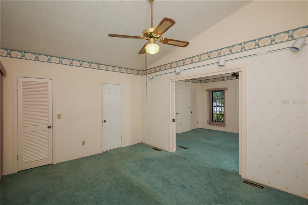 Bedroom 3 w/walk in closet - Single Family Home for sale at 7611 Alhambra Dr, Bradenton, FL 34209 - MLS Number is A4434753