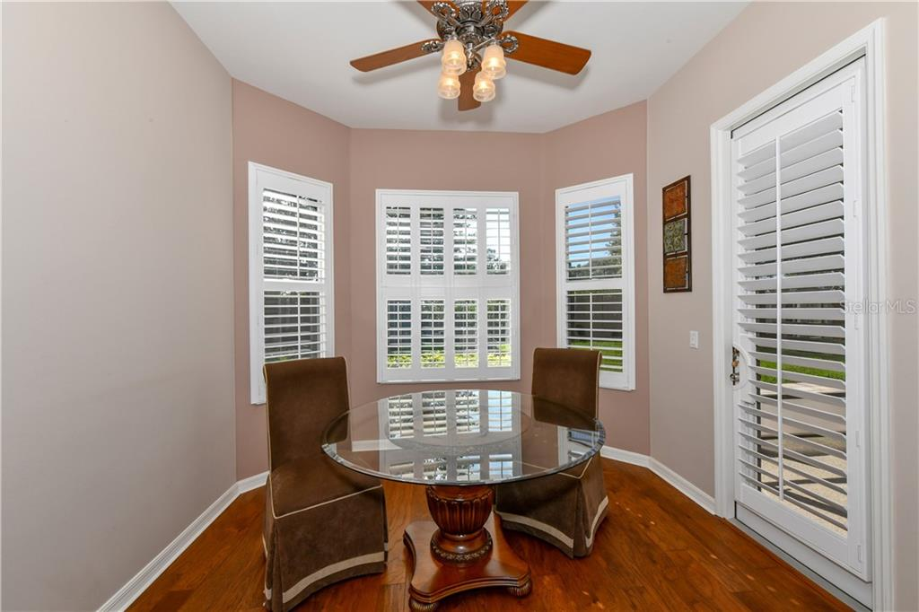 Dinette with bay window & plantation shutters. - Single Family Home for sale at 2745 Harvest Dr, Sarasota, FL 34240 - MLS Number is A4436381