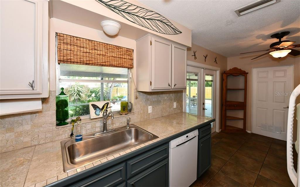 Kitchen with window overlooking the backyard. - Single Family Home for sale at 120 23rd Street Ct Ne, Bradenton, FL 34208 - MLS Number is A4438232