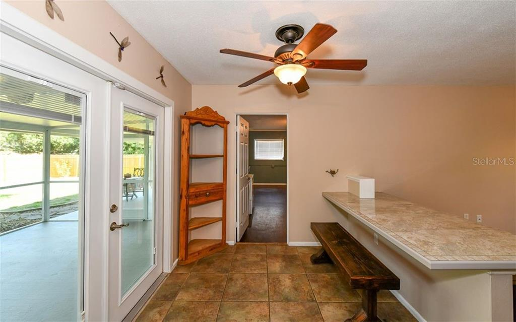 Dining area looking into the laundry/office. - Single Family Home for sale at 120 23rd Street Ct Ne, Bradenton, FL 34208 - MLS Number is A4438232