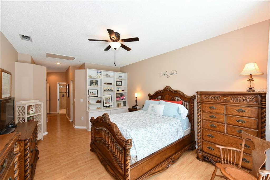 Master Bedroom with built-in shelves and 2 closets - Single Family Home for sale at 4074 Via Mirada, Sarasota, FL 34238 - MLS Number is A4439141