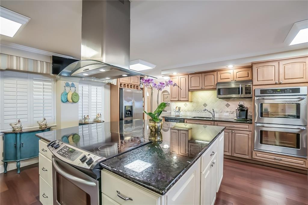 Double sized Kitchen with large granite island - Condo for sale at 20 Whispering Sands Dr #102 & 103, Sarasota, FL 34242 - MLS Number is A4441587