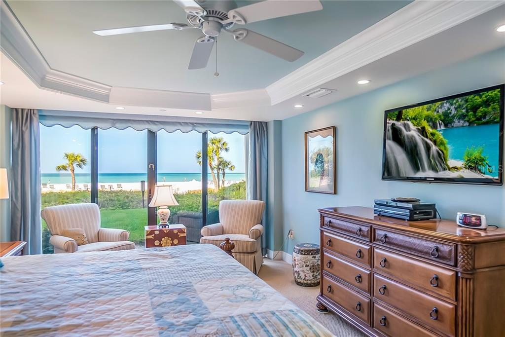Master Bedroom with Crown molding/tray ceiling. - Condo for sale at 20 Whispering Sands Dr #102 & 103, Sarasota, FL 34242 - MLS Number is A4441587