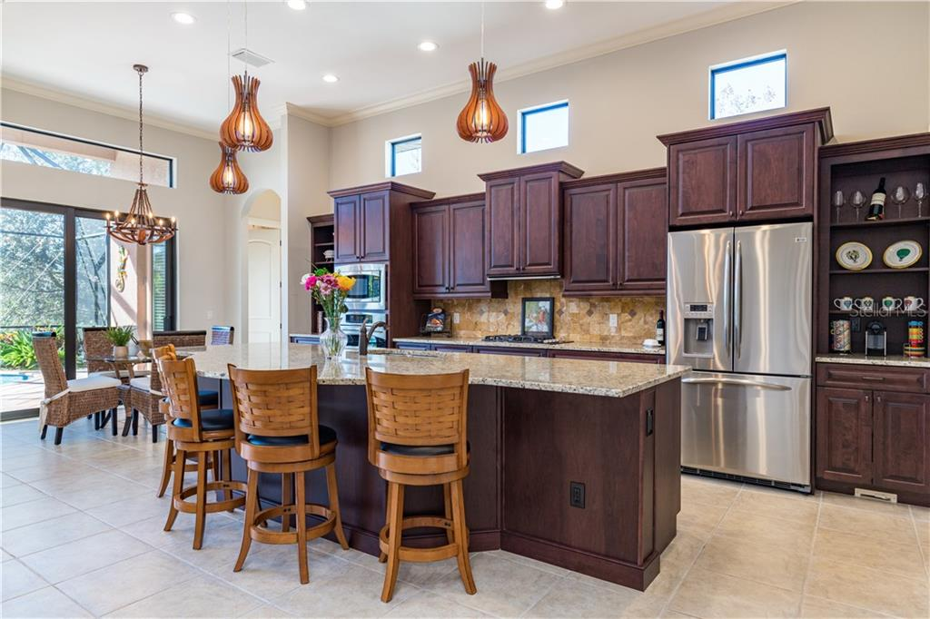 Notice the curved island - Single Family Home for sale at 14710 Leopard Creek Pl, Lakewood Ranch, FL 34202 - MLS Number is A4442202