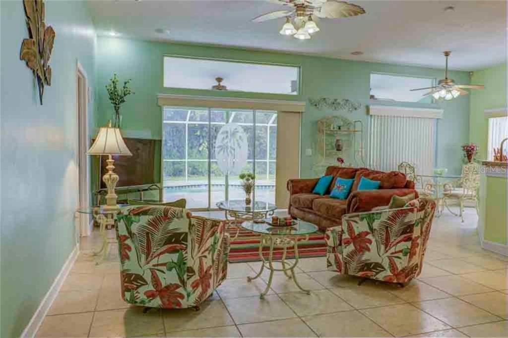 Open and bright with lots of windows overlooking the pool and preserve beyond.  Sliders retract to pocket doors allowing you to enjoy the private view at your leisure! - Single Family Home for sale at 5109 76th St E, Bradenton, FL 34203 - MLS Number is A4443335