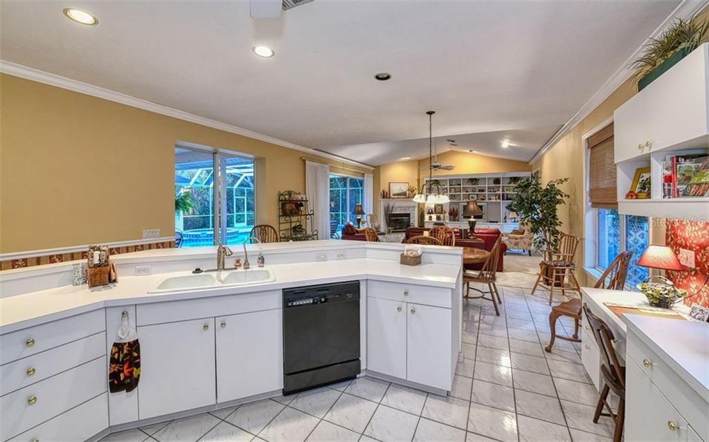 Kitchen overlooking family room and pool - Single Family Home for sale at 2316 Nw 85th St Nw, Bradenton, FL 34209 - MLS Number is A4445702