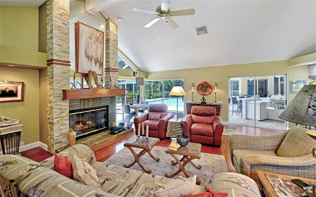 Inviting family room with gas fireplace! - Single Family Home for sale at 4839 Windsor Park, Sarasota, FL 34235 - MLS Number is A4449948