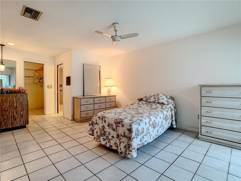 Master bedroom looking toward walk-in closet and en-suite bathroom. - Single Family Home for sale at 7006 18th Ave W, Bradenton, FL 34209 - MLS Number is A4450658