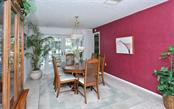 Dining room with french door to lanai. - Single Family Home for sale at 465 E Royal Flamingo Dr, Sarasota, FL 34236 - MLS Number is A4187554