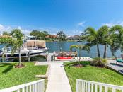 Elevation above flood plain,  2 Docks with lifts, fishing and kayaks, paddle boards or jets area - Single Family Home for sale at 7643 Cove Ter, Sarasota, FL 34231 - MLS Number is A4403215