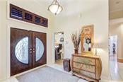 Beautiful stained glass entry doors - Single Family Home for sale at 6321 W Glen Abbey Ln E, Bradenton, FL 34202 - MLS Number is A4429610