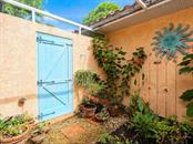 Private garden and outdoor shower off master bathroom - Single Family Home for sale at 1716 Bayshore Dr, Englewood, FL 34223 - MLS Number is A4445961