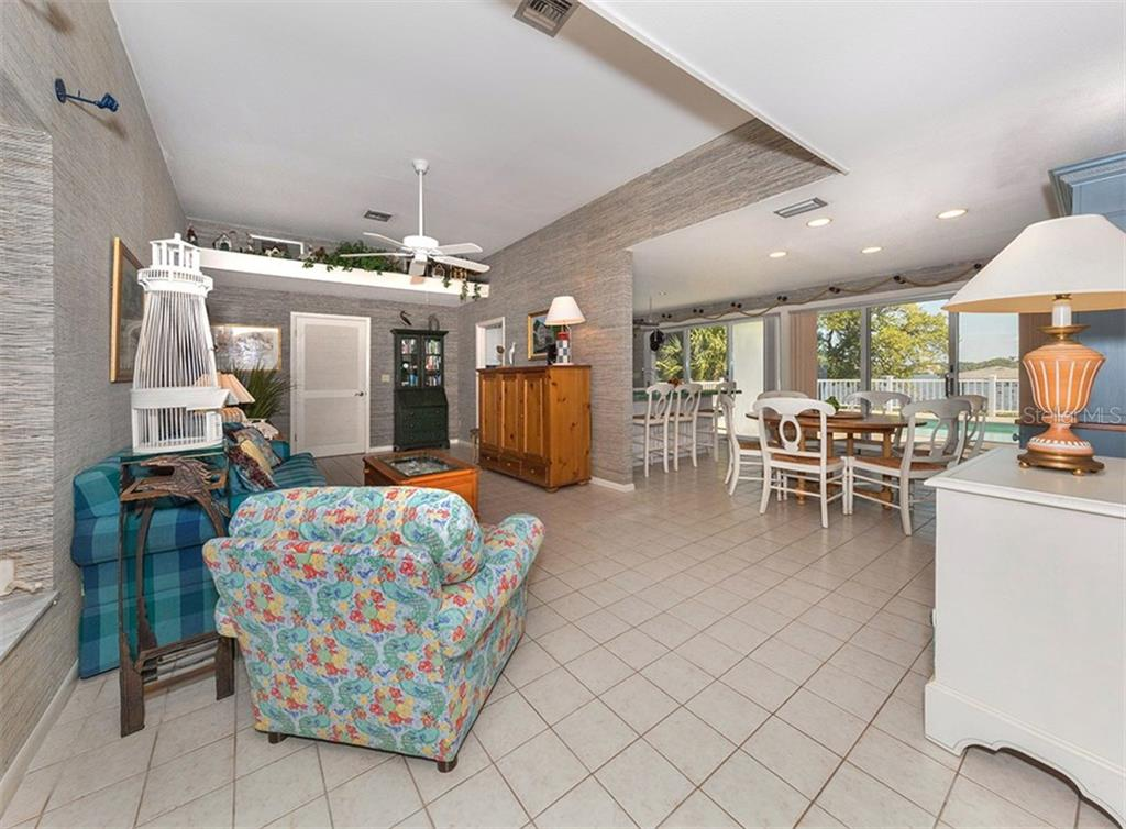 Family room and dining room both offer views of the pool and bay. - Single Family Home for sale at 3509 Casey Key Rd, Nokomis, FL 34275 - MLS Number is N5915098