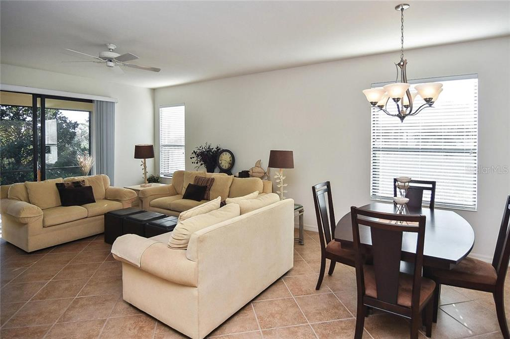 Dining room, living room - Villa for sale at 11108 Batello Dr, Venice, FL 34292 - MLS Number is N6104651