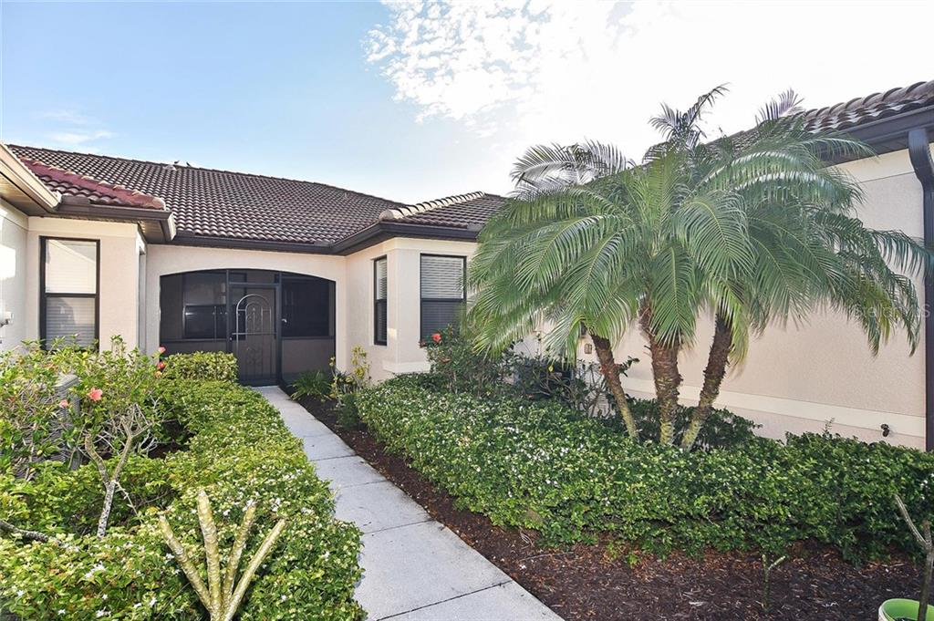Walkway to entry - Villa for sale at 11108 Batello Dr, Venice, FL 34292 - MLS Number is N6104651