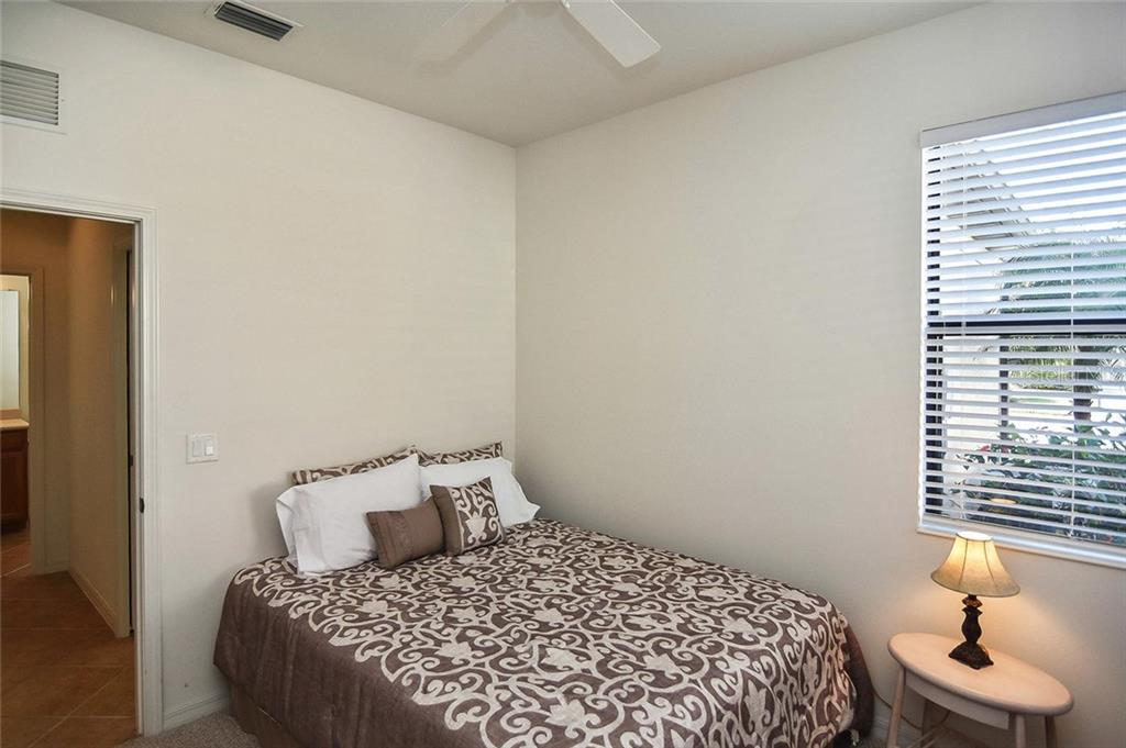 Guest bedroom - Villa for sale at 11108 Batello Dr, Venice, FL 34292 - MLS Number is N6104651