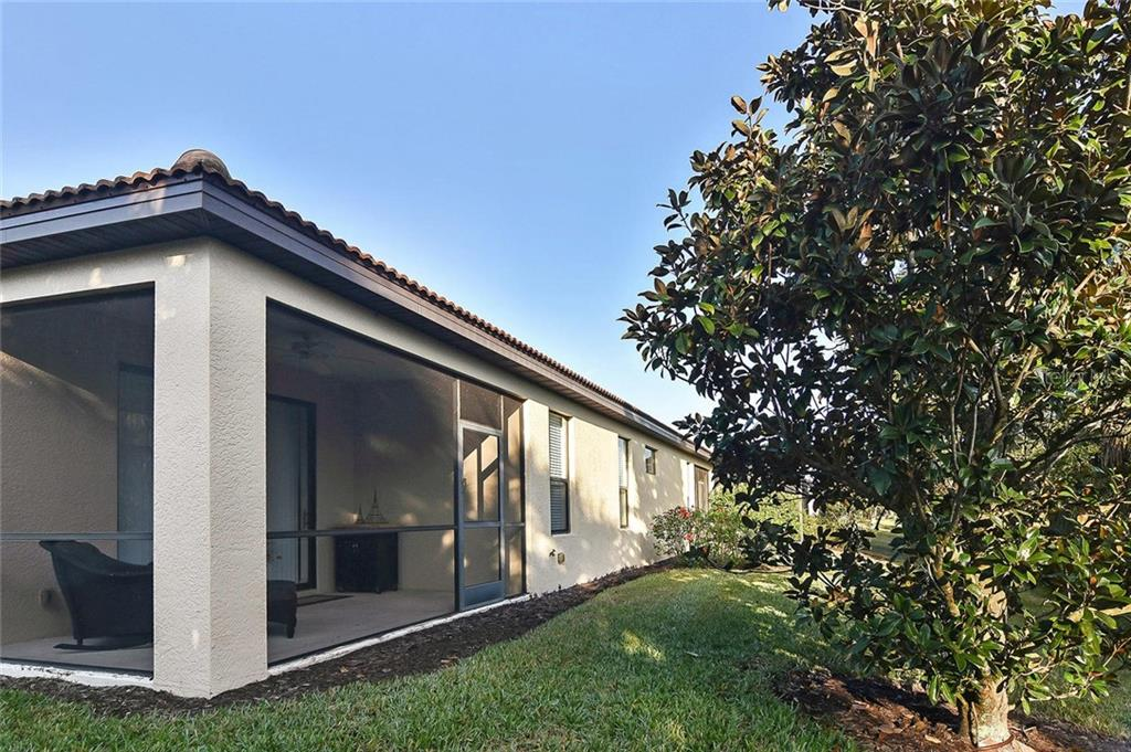 Rear exterior - Villa for sale at 11108 Batello Dr, Venice, FL 34292 - MLS Number is N6104651