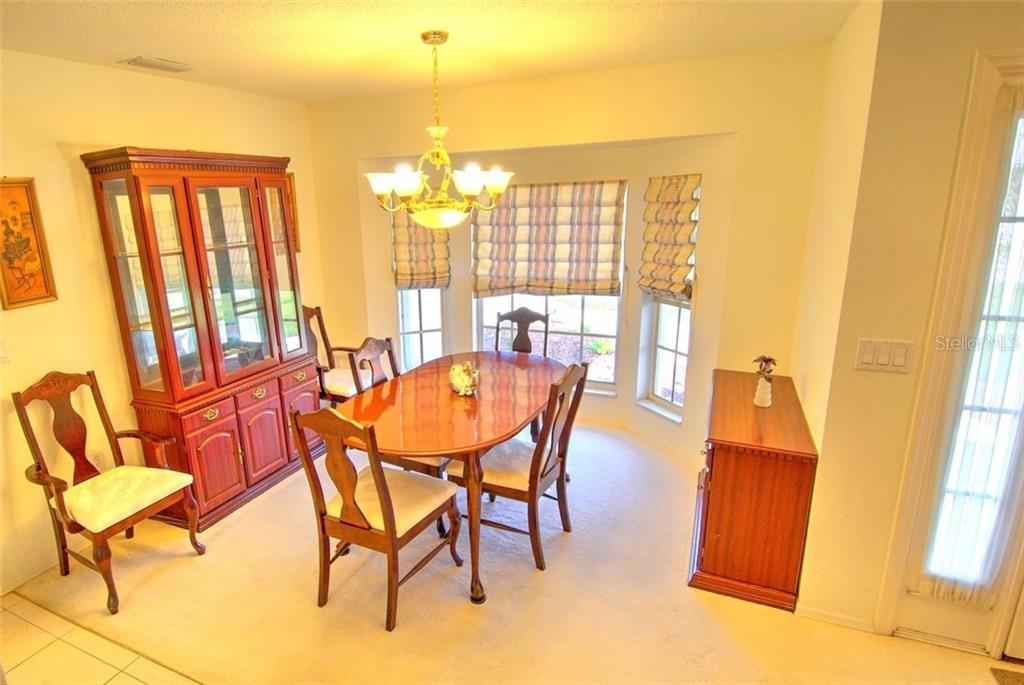 Formal Dining Room - Single Family Home for sale at 4884 Jacaranda Heights Dr, Venice, FL 34293 - MLS Number is N6105548